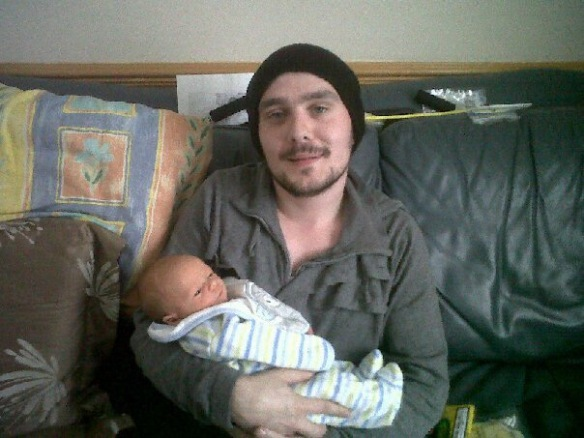 Here I am holding my new born nephew, I was very ill in this picture.